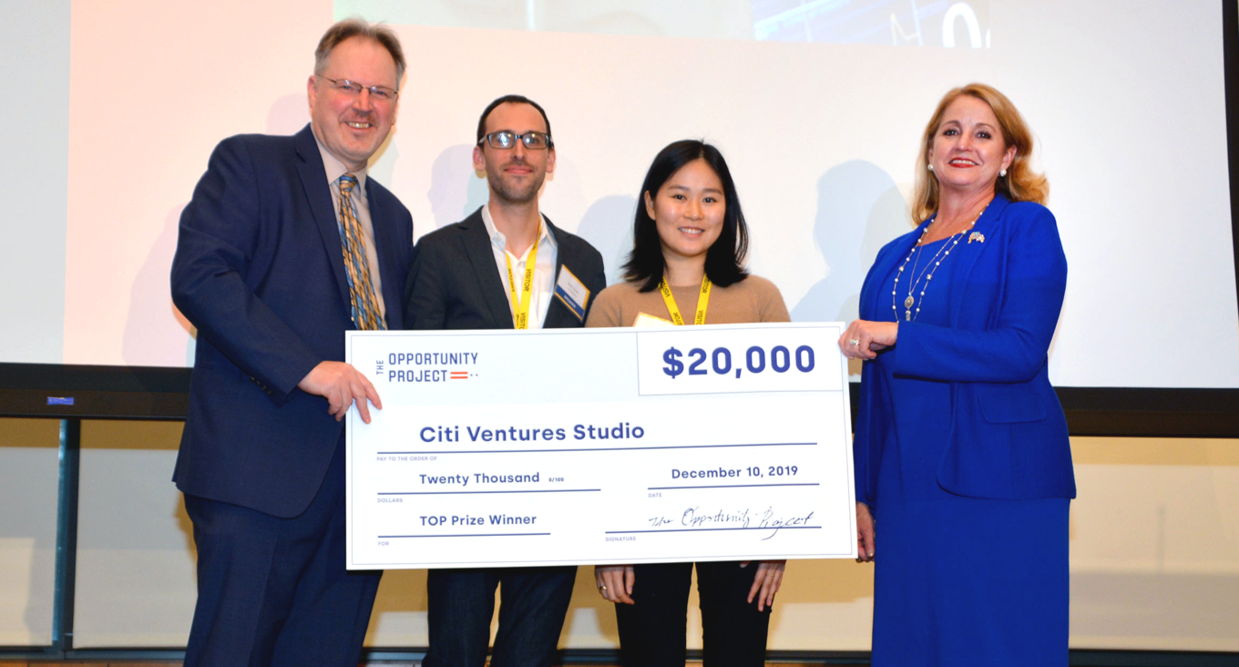The Citi Ventures team at Demo Day presented with a big check prize of $20,000 for winning in one category of the 2019 TOP Prize Competition