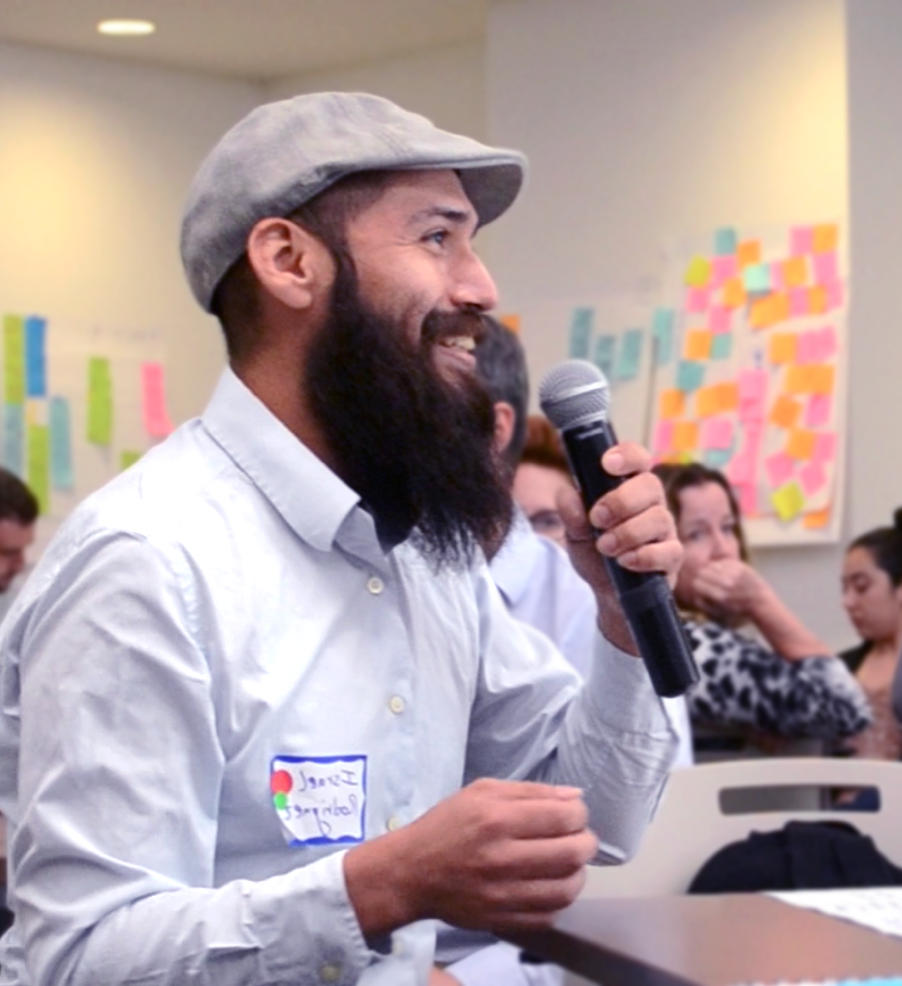 Man speaking into microphone at a user engagement workshop hosted by The Opportunity Project