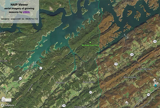 Screenshot of the NAIP viewer. The image was acquired on 2018/11/11, and displays an arial view of the Big Ridge State Park. The left side of the park is a dark green, and the right side is a dark brown.