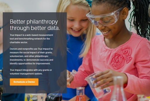 Screenshot of True Impact platform that shows two smiling school-aged girls doing a science experiment. A text overlay describes