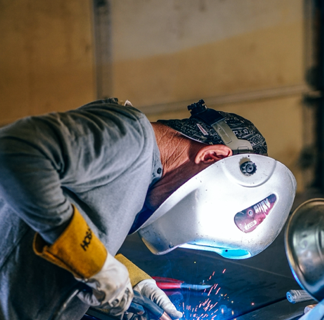 Man in protective equipment welding